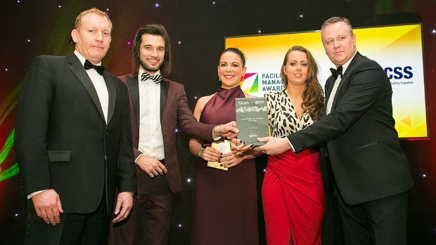 Karen O'Connor, Deb Group and Claire Murphy, FM Sector Leader, Bunzl Cleaning & Safety Supplies presents the Cleaning Service Provider of the Year award to Jonathan McKinlay, Gavin Annon and Cathal Geoghan