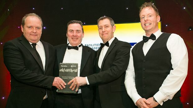 Eoin Manley, Group Facilities Manager and Acting H&S, Dalata Hotel Group presents the Innovation in Technology & Systems – Providers award to Derick Murphy, Eanna Mac Giolla Phadraig and Aidan Murphy, iGuide Mobile Applications