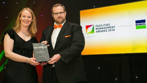 Paraic O' Lochainn, General Manager, eMaint presents the Facilities Management CSR Initiative of the Year award to Karen Coyle, AIB Environment