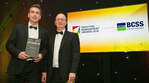 Pat Gaughan, Managing Director, Advanced Workplace Solutions presents the Excellence in Health & Safety award to Declan Kearney, Flynn