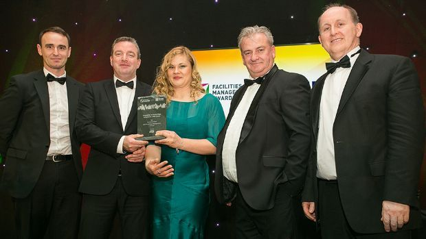 David Norton, Key Account Manager, Essity Ireland presents the Innovation in Technology & Systems - End Users award to BAM Facilities Management Ireland Team