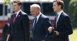 Former White House staff secretary Rob Porter, chief of staff John Kelly and senior adviser Jared Kushner. Porter's resignation this month after domestic abuse allegations against him became public has increased White House tensions.   Photograph:  Tom Brenner/The New York Times