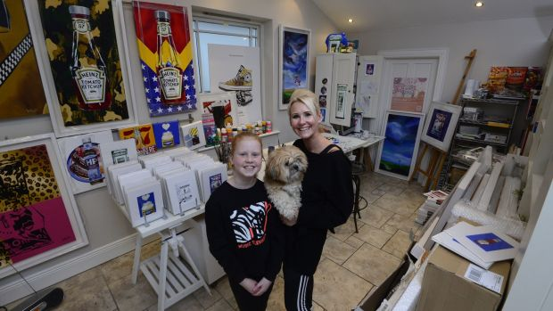 Artist Orla Walsh with her daughter and the family dog at her studio in Foxrock. Photograph: Cyril Byrne
