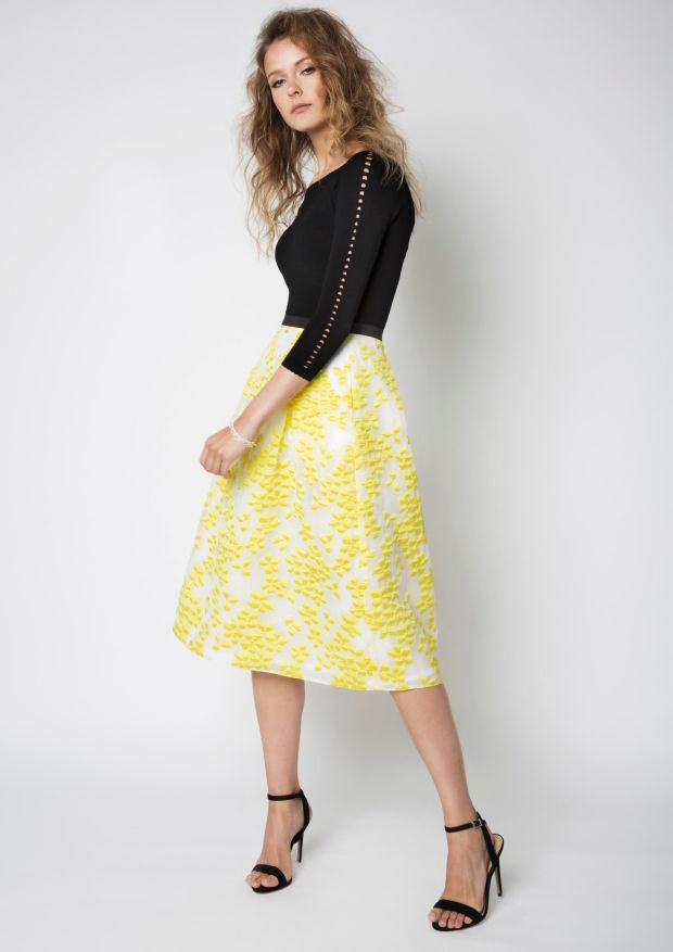 Yellow jacquard skirt (€180) and black knit top (€105) by FeeG