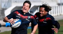 Francois Trinh Duc is chased by  Mathieu Bastareaud during a training session at the Maurice David stadium in Aix-en-Provence ahead of Friday's Six Nations game against Italy in Marseille. Photograph: Christophe Simon/AFP/Getty Images