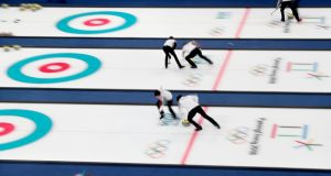 An image taken with a slow shutter speed shows teams in action during the Curling Mixed Doubles round-robin match in Gangneung during the Winter Olympics. Photograph: Javier Etxezarreta/EPA