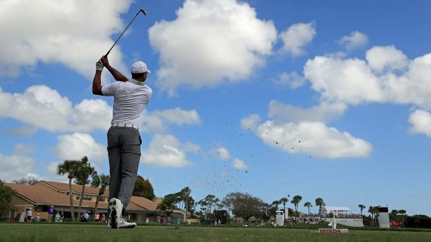 Tiger Woods plays a tee shot during the pro-am for the Honda Classic in Palm Beach Gardens, Florida. Photograph: Mike Ehrmann/Getty Images