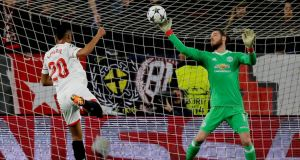 Manchester United's David De Gea makes a save from Sevilla's Luis Muriel during the Champions League round of 16 first leg game  at the Sánchez Pizjuán stadium. Photograph: Jon Nazca/Reuters