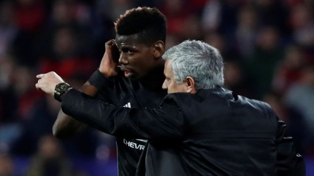Manchester United manager Jose Mourinho gives instructions to Paul Pogba as the midfielder goes on in the first half of the Champions League round of 16 first leg against Sevilla at the Ramon Sánchez Pizjuán stadium. Photograph: Juan Medina/Reuters
