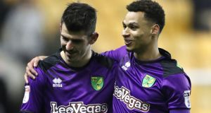 Norwich City goalscorer  Nelson Oliveira (left) gets a hug from Josh Murphy at the end of the  Championship match against Wolves at Molineux. Photograph:   Nick Potts/PA Wire