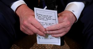 US president Donald Trump's notes for hosting a listening session with students survivors of mass shootings. Photograph: Chip Somodevilla/Getty Images