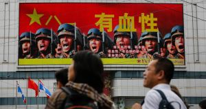 A screen promotes recruitment for the Chinese People's Liberation Army: Beijing has territorial disputes of varying degrees with all of its neighbours. Photograph: Andy Wong