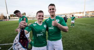 James Hume  with Michael Lowry after their under-19 friendly match against Japan last March. Photograph: Inpho