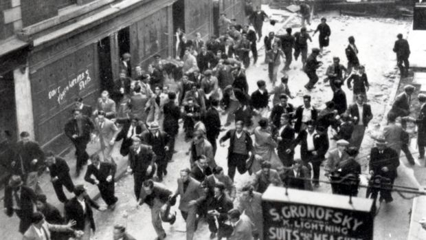 Battle of Cable Street: An anti-Fascist crowd, some of them carrying missiles, ran from a barricade they had erected near Aldgate as police charge. Photograph: Jewish Chronicle/Heritage Images/Getty Images