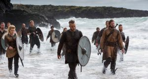 """Vikings in Focus"",  by Jonathan Hession and Bernard Walsh is an exhibition of stills photography from the set of the acclaimed TV series shot in Ashford Studios Co Wicklow. Image : The Vikings land on the Northumbrian Coast, filmed at Silver Strand, Wicklow.   Photograph: Jonathan Hession"