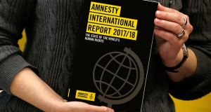 A copy of the Amnesty International Report 2017/18. Photograph: Reuters