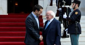 Greek prime minister Alexis Tsipras welcomes President Michael D Higgins  in Athens during his state visit. Photograph: Alkis Konstantinidis/Reuters