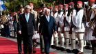 President Michael D Higgins and his Greek counterpart Prokopis Pavlopoulos inspect the presidental Evzoni guards, during the official welcome ceremony outside the presidental palace in Athens. Photograph: Louisa Gouliamaki/AFP/Getty Images