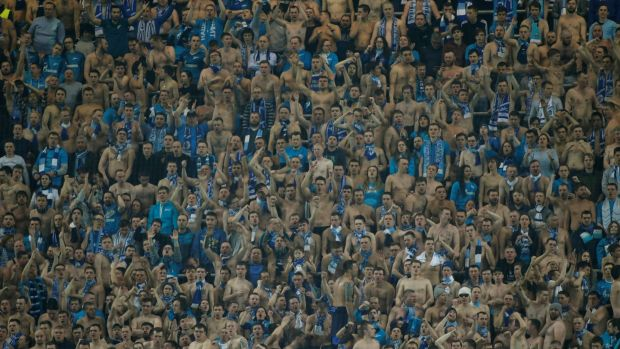 Zenit St Petersburg fans celebrate during the game. Photograph: Maxim Shemetov/Reuters