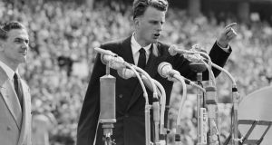 Billy Graham preaches to over 100,000 Berliners at the Olympic Stadium in Berlin, Germany, in June 1954. He died at his home in North Carolina on Wednesday aged 99. File photograph: AP