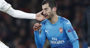 Arsenal's Armenian midfielder Henrikh Mkhitaryan gets a finger in the eye from Ostersunds' English midfielder Jamie Hopcutt. Photograph: Getty Images