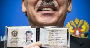 Businessman and Communist Party nominee Pavel Grudinin display his presidential candidate certificate shortly after receiving it at the Central Election Commission in Moscow. Photograph: Alexander Nemenov/AFP/Getty
