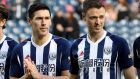 Gareth Barry and Jonny Evans: two of the four West Brom  players that nicked a taxi at five in the morning outside a McDonald's in Spain. Photograph: Nick Potts/PA