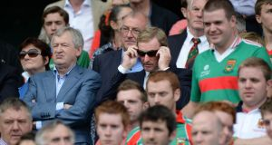 Páraic Duffy with taoiseach Enda Kenny watch Mayo play Tyrone in the All-Ireland senior  football championship semi-final at Croke Park in August 2013. Photograph: Dara Mac Dónaill