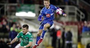Waterford's Dean O'Halloran is tackled by Steven Beattie of Cork City. Photo: Laszlo Geczo/Inpho