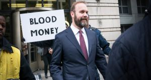 Rick Gates, a longtime protégé and junior partner of Donald Trump's presidential campaign chairman Paul Manafort, leaves the E. Barrett Prettyman federal courthouse in Washington on Friday. Photograph: Erin Schaff/The New York Times