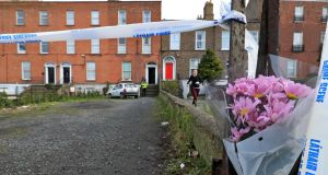 Flowers at the scene at the house on Ranelagh Road, Dublin where the body of Joanne Lee was discovered in a wardrobe last week. Photograph: Colin Keegan, Collins Dublin.