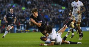 Huw Jones  the third Scotland try under pressure from Anthony Watson and Mike Brown. Photograph: Shaun Botterill/Getty Images
