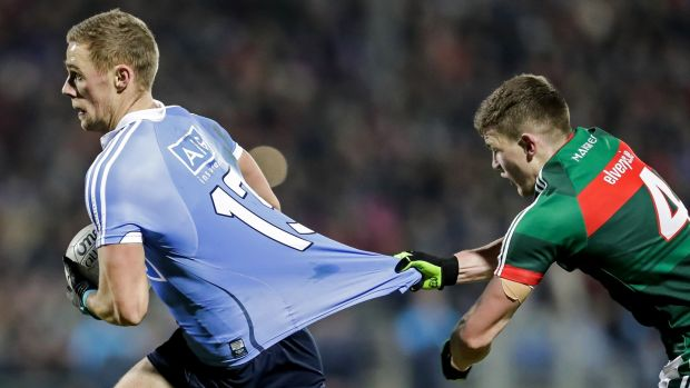 Dublin's Paul Mannion is held back by Eoin O'Donoghue of Mayo. Photograph: Laszlo Geczo/Inpho