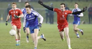 Monaghan's Fintan Kelly is chased by Colm Cavanagh of Tyrone during their Allianz League meeting. Photo: Declan Roughan/Inpho