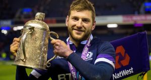 Finn Russell with the Calcutta Cup. Photograph: Craig Watson/Inpho