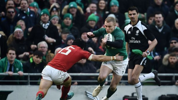 Keith Earls takes on Leigh Halfpenny at the Aviva. Photograph: Charles McQuillan/Getty