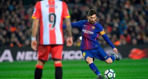 Lionel Messi shone during Barcelona's win over Girona. Photograph: Lluis Gene/AFP