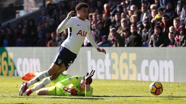 Dele Alli goes to ground during Tottenham's narrow win over Crystal Palace. Photograph: Steven Paston/PA