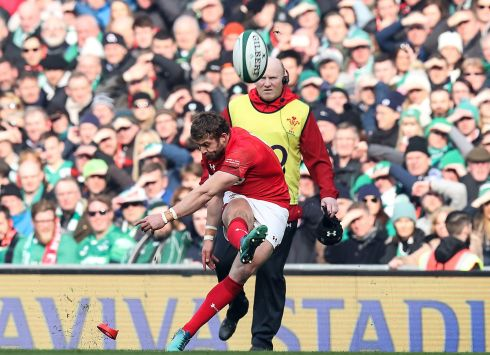 Wales' fullback Leigh Halfpenny kicks a penalty. Photograph: Inpho