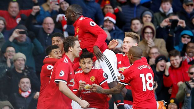 Romelu Lukaku celebrates with his United teammates after Lingard's goal. Photo: Martin Rickett/PA Wire