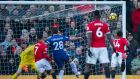 Manchester United's Jesse Lingard scores the winner in their Premier League clash with Chelsea. Photo: Peter Powell/EPA