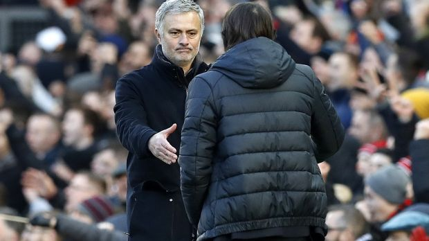 Antonio Conte and Jose Mourinho shake hands after the game. Photo: Martin Rickett/PA Wire