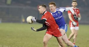 Monaghan's Kieran Duffy closes in on Dermot Malone of Tyrone. Photograph: Declan Roughan/Inpho