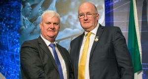 Ex-president of the Gaelic Athletic Association Aogan Ó Fearghail hands over his president's medal to incoming president John Horan. Photograph: Oisin Keniry/Inpho