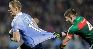Dublin's Paul Mannion  gets a way from Eoin O'Donoghue of Mayo during Saturday's Allianz Laegue game at MacHale Park. Photograph: Laszlo Geczo/Inpho