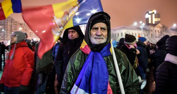 Protesters against corruption this week outside the Romanian government headquarters in Bucharest. Photograph: Daniel Mihailescu/Getty