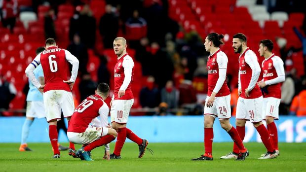 Arsenal players stand dejected at the end of the game. Photo: Nick Potts/PA Wire