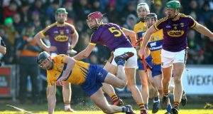 Wexford's Paudie Foley and Michael O'Malley of Clare battle for the ball during their Allianz Hurling League Division 1A clash at Nowlan Park. Photo: Ryan Byrne/Inpho