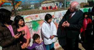 Second term: President Michael D Higgins with children at the Eleonas migrant and refugee camp during his visit to Greece, where he gave the first public confirmation that he might consider running again. Photograph: AFP/Getty