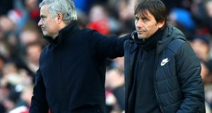 Jose Mourinho and Antonio Conte shake hands after the Premier League match between Manchester United and Chelsea at Old Trafford on Sunday. Photograph: Clive Brunskill/Getty Images